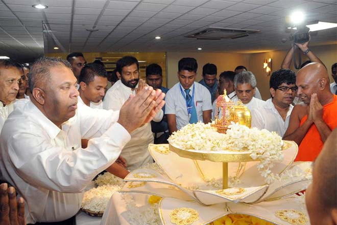 FM Mangala receives bone relics from Myanmar for Vesak viewing at the airport