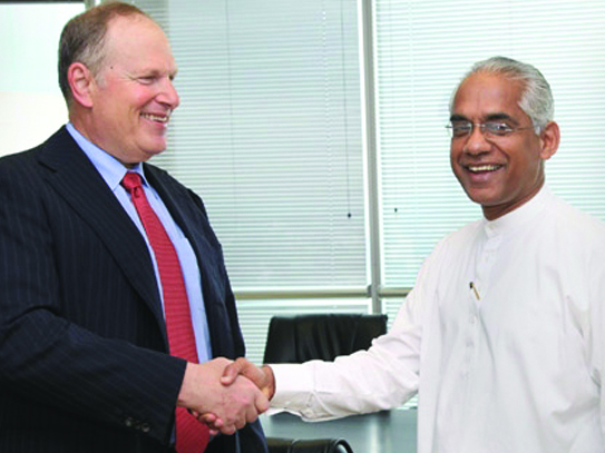 Chairman of Honeywell Corporation Dave Cote with  Former Deputy Minister of Investment Promotion Eran Wickramaratne