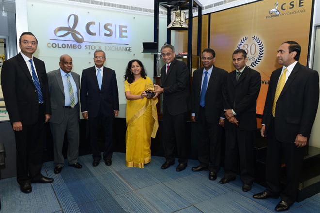 (Left to Right): Executive Director and Vice President - Finance & Control (NEST) Mr. Jagdish Kumar Singla, Non-Executive Director (NEST) Mr. Ranjan Seevaratnam, Non-Executive Director (NEST) Mr. Mahen Dayananda, Managing Director (NEST) Mrs. Shivani Hegde, Chairman (CSE) Mr. Vajira Kulatilaka, Assistant Vice President-Corporate Affairs & Communications (NEST) Mr. Bandula Egodage, Company Secretary and Legal Counsel (NEST) Mr. Lioshon Rajapakshe from Nestlé Lanka PLC and CEO Mr. Rajeeva Bandaranaike (CSE).