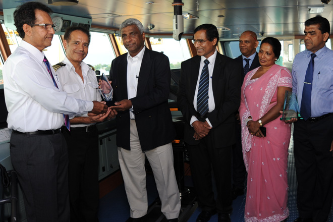 SLPA Chairman Mr.Dammika Ranatunga exchanging plaques with the Capt.of the vessel and Mr.Saliya Senanayake, Managing Director of SIMATECH Marine Lanka to mark the maiden call of  Mv. Sima Giselle in Colombo. Secretary to the Ministry of Ports and Shipping Mr. L.P. Jayampathi and Additional Secretary to the Ministry Mrs. Kanthi Perera, Chairman of Ceylon Shipping Corporation Ltd; - Mr. Sashi Dhanathunge, Vice Chairman of SLPA - Dr. Prasanna Perera, Executive Director- Mr. Sanjeewa Wijeratne, the Director (Operations) of SLPA – Mr.Upali De Zoysa and Director (Finance) – Mrs. Shirani Wanniarachchi are also in the picture.