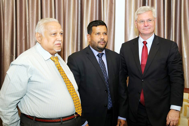 From left: Harold (Harry) Jayawardena (the Leading Lankan Businessman and Danish Honorary Consul General in Colombo), Minister of Industry and Commerce Rishad Bathiudeen and (HE) Danish Ambassador for Sri Lanka Peter Taksøe-Jensen pose for cameras at the Ministry of Industry and Commerce, Colombo on 12 January