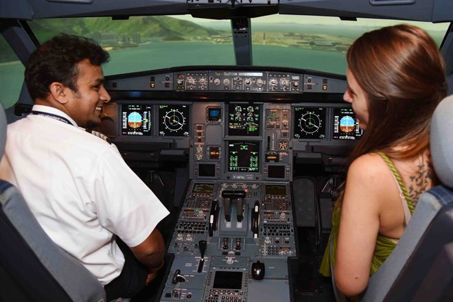 Travel bloggers experience SriLankan Airlines flight simulator