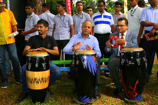 Minister Sagala plays drums at Naadro Bera Fest