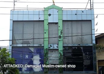 Damaged Muslim-owned store in in Sri Lanka targeted by nationalists