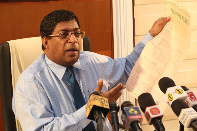 Sri Lanka's Finance Minister Ravi Karunanayake accuses Attorney General Department
