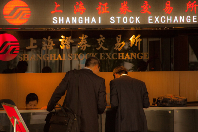 China stocks fall 5.4 pct on brokerage probes